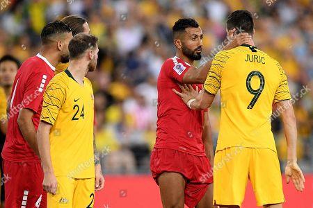 Joan Oumari (2-R) of Lebanon in action against Tomi Juric (R) of Australia during the International Friendly soccer match between Australia and Lebanon in Sydney, Australia, 20 November 2018.