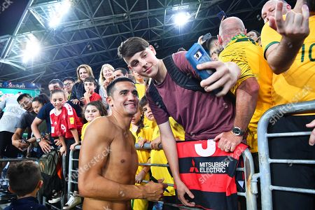 Australia's Tim Cahill (C) poses for selfies with fans after the International Friendly soccer match between Australia and Lebanon in Sydney, Australia, 20 November 2018.