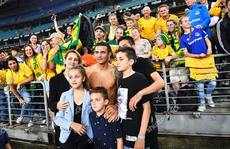 Australia's Tim Cahill (C) is flanked by his family as he greets fans after the International Friendly soccer match between Australia and Lebanon in Sydney, Australia, 20 November 2018.