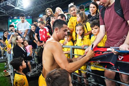 Australia's Tim Cahill (C) signs autographs after the International Friendly soccer match between Australia and Lebanon in Sydney, Australia, 20 November 2018.