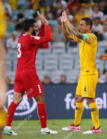 Tim Cahill, Moot Az Bellah El Jounaidi. Australia's Tim Cahill, right, is congratulated by Lebanon's Moot Az Bellah El Jounaidi at the end of their international soccer friendly in Sydney