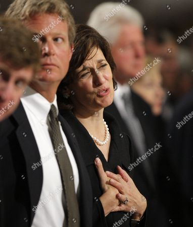 Senator Edward Kennedy's widow Vicki Reggie Kennedy puts her hands over her heart to thank tenor Placido Domingo for singing Franck's 'Panis Angelicus' at communion as she stands next to her son Edward Kennedy Jr.