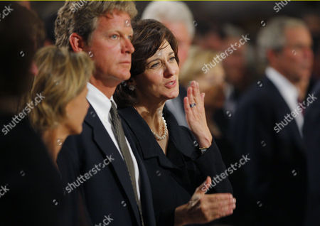 Senator Edward Kennedy's widow Vicki Reggie Kennedy throws a kiss to thank tenor Placido Domingo for singing Franck's 'Panis Angelicus' at communion as she stands next to Kennedy's daughter Kara Kennedy Allen (L) and son Edward Kennedy Jr. (C)