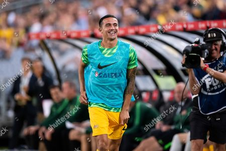 Stock Picture of Australian forward Tim Cahill warms up ready to come on the field at the international soccer match between Australia and Lebanon at ANZ Stadium in NSW, Australia.