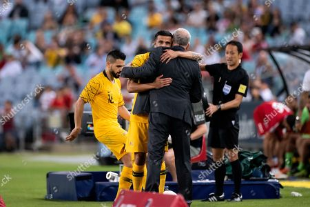 Australian forward Tim Cahill gets some last minute instructions from Australian coach Graham Arnold at the international soccer match between Australia and Lebanon at ANZ Stadium in NSW, Australia.