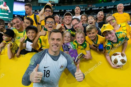 Australian goalkeeper Danny Vukovic (18) gives the thumbs up with fans at the international soccer match between Australia and Lebanon at ANZ Stadium in NSW, Australia.