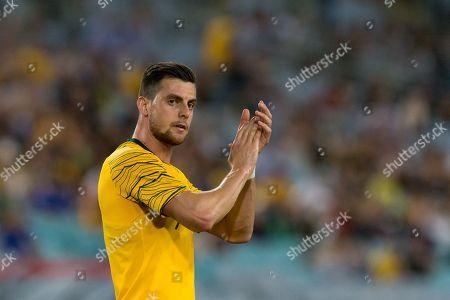 Australian forward Tomi Juric (9) claps at the international soccer match between Australia and Lebanon at ANZ Stadium in NSW, Australia.