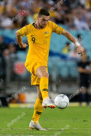 Australian forward Tomi Juric (9) controls the ball at the international soccer match between Australia and Lebanon at ANZ Stadium in NSW, Australia.