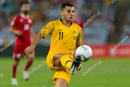 Australian forward Andrew Nabbout (11) controls the ball at the international soccer match between Australia and Lebanon at ANZ Stadium in NSW, Australia.