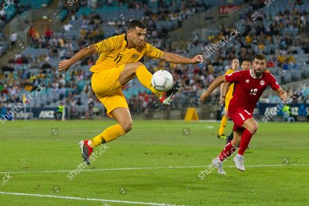 Stock Photo of Australian forward Andrew Nabbout (11) controls the ball at the international soccer match between Australia and Lebanon at ANZ Stadium in NSW, Australia.