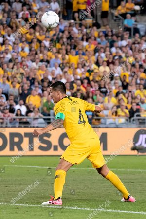 Lebanon player Kasssem El Zein (2) gets a head to the ball before Australian forward Tim Cahill (4) at the international soccer match between Australia and Lebanon at ANZ Stadium in NSW, Australia.