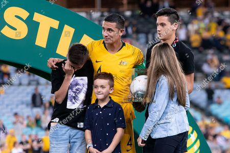 An emotional Australian forward Tim Cahill (4) with his family after his last game at the international soccer match between Australia and Lebanon at ANZ Stadium in NSW, Australia.