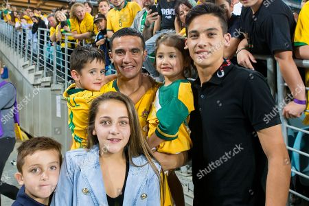 Australian forward Tim Cahill (4) with his kids at the international soccer match between Australia and Lebanon at ANZ Stadium in NSW, Australia.