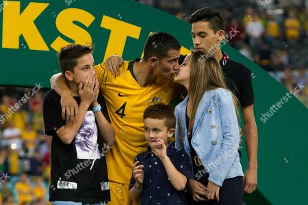 Stock Photo of Australian forward Tim Cahill (4) gives his daughter a kiss during his final match presentation at the international soccer match between Australia and Lebanon at ANZ Stadium in NSW, Australia.