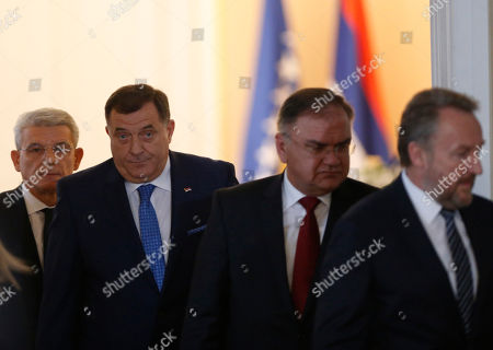 Stock Picture of Milorad Dodik, Zeljko Komsic, Sefik Dzaferovic. Members of Bosnia's newly elected tripartite presidency, Bosnian Serb member Milorad Dodik, second left, and Muslim member Sefik Dzaferovic, first left, enter the room for inauguration with old members of presidency Muslim member Bakir Izetbegovic, first right, and Serb member Mladen Ivanic, second right ahead of the inauguration ceremony in Sarajevo, . Bosnia's three-member presidency has been inaugurated after last month's election with nationalist politicians forming a majority on a body designed to heal the country's ethnic divide
