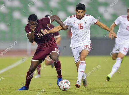 Mehdi Torabi (R) of Iran fights for the ball with Sergio Cordova (L) of Venezuela during the International friendly soccer match between Iran and Venezuela at Al Ahli Stadium, in Doha, Qatar, 20 November 2018.