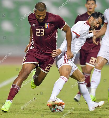 Stock Image of Masoud Shojaei (R) of Iran fights for the ball with Salomon Rondon (L) of Venezuela during the International friendly soccer match between Iran and Venezuela at Al Ahli Stadium, in Doha, Qatar, 20 November 2018.