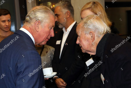 Prince Charles speaks to Desinger Sir Terence Conran as he visits the Dyson Building at Royal College of Art