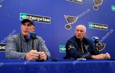 Craig Berube, left, speaks during a news conference along side St. Louis Blues general manager Doug Armstrong after Berube was named interim head coach of the NHL hockey team, in St. Louis. The Blues fired head coach Mike Yeo following a 2-0 loss to the Los Angeles Kings Monday night