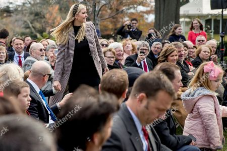 Ivanka Trump, Theodore James Kushner. Ivanka Trump, the daughter of President Donald Trump, grabs her youngest child, Theodore James Kushner, as he runs into the audience before President Donald Trump and first lady Melania Trump arrive for a ceremony to pardon the National Thanksgiving Turkey in the Rose Garden of the White House in Washington