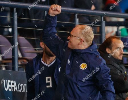 Scotland Manager Alex McLeish celebrates after the final whistle.