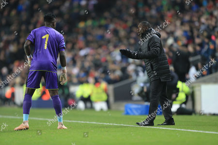 Stock Picture of Clarence Seedorf Head coach of Cameroon instructs Andre Onana of Cameroon