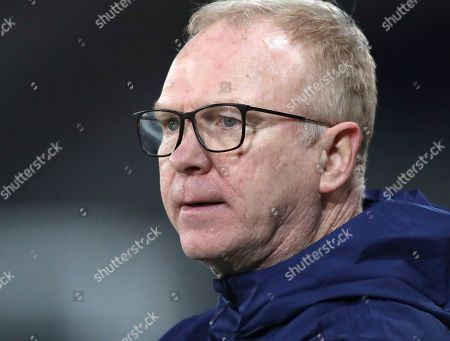 Scotland's head coach Alex McLeish waits for the start of the UEFA Nations League soccer match between Scotland and Israel at Hampden Park, in Glasgow, Scotland