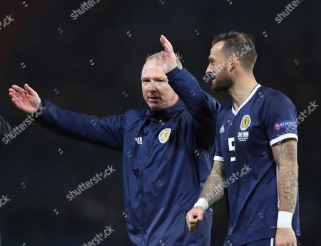 Scotland's head coach Alex McLeish, left, and Scotland's Steven Fletcher celebrate their victory during the UEFA Nations League soccer match between Scotland and Israel at Hampden Park, in Glasgow, Scotland