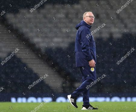 Scotland's head coach Alex McLeish walks in the pitch at the end of the UEFA Nations League soccer match between Scotland and Israel at Hampden Park, in Glasgow, Scotland