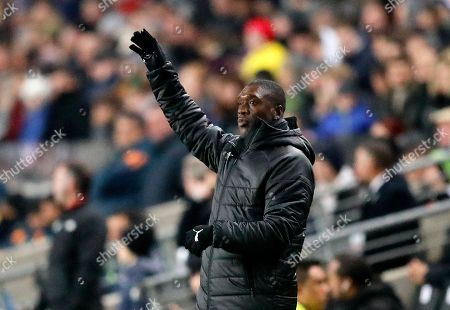 Cameroon's manager Clarence Seedorf reacts during the International friendly soccer match between Brazil and Cameroon at MK Stadium in Milton Keynes, England