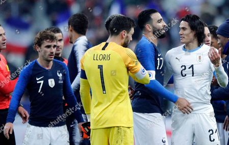 French President Emmanuel Macron and South Korean President Moon Jae-in attend a meeting at the Elysee Palace in Paris. Uruguay's Edinson Cavani, right, congratulates French players, Adil Rami, 2nd right, and Hugo Lloris, while France's Antoine Griezmann, left, looks on at the end of an international friendly soccer match between France and Uruguay at the Stade de France stadium in Saint-Denis, outside Paris, . France defeated Uruguay 1-0