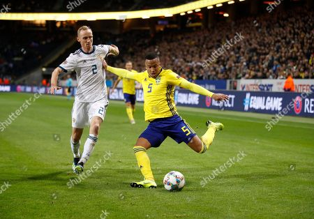 Russia´s Vladislav Ignatyev and Sweden´s Martin Olsson during the UEFA Nations League soccer match between Sweden and Russia at Friends Arena in Stockholm, Sweden November 20, 2018.