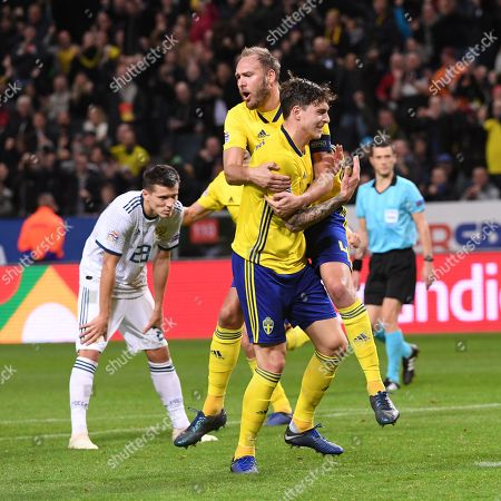 Stock Picture of Sweden´s Victor Nilsson Lindelof and Andreas Granqvist celebrates Victor Nilsson Lindelof´s 1-0 goal during the UEFA Nations League soccer match between Sweden and Russia at Friends Arena in Stockholm, Sweden November 20, 2018.