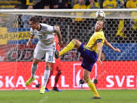 Stock Photo of Russia´s  Anton Zabolotny and Sweden´s Andreas Granqvist  during the UEFA Nations League soccer match between Sweden and Russia at Friends Arena in Stockholm, Sweden November 20, 2018.