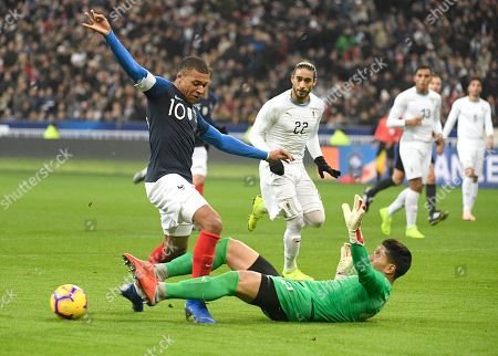 Kylian Mbappe (L) of France and Martin Campana (bottom) of Uruguay in action during the International friendly soccer match between France and Uruguay at the Stade de France in Saint-Denis, outside Paris, France, 20 November 2018.