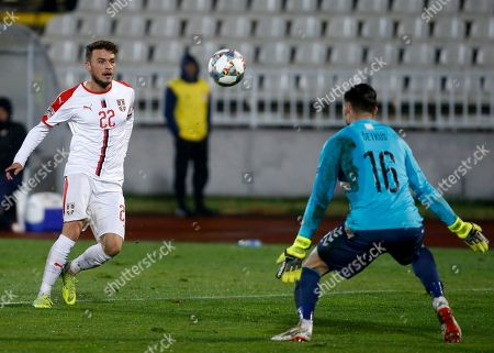 Serbia's Adem Ljajic, left, scores his side's fourth goal during the UEFA Nations League soccer match between Serbia and Lithuania at Partizan stadium in Belgrade, Serbia