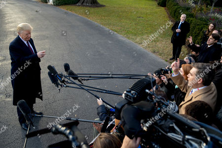 President Donald Trump takes a question from CNN reporter Jim Acosta, right, before boarding Marine One on the South Lawn of the White House in Washington, for a short trip to Andrews Air Force Base, Md., and then on to Palm Beach Fla