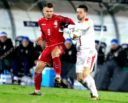 Serbia's Antonio Rukavina (R) in action against Lithuania's Donatas Kazlauskas (L) during the UEFA Nations League soccer match between Serbia and Lithuania in Belgrade, Serbia, 20 November 2018.