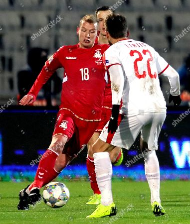 Lithuania's Modestas Vorobjovas (L) in action against Serbia's Adem Ljajic (R) during the UEFA Nations League soccer match between Serbia and Lithuania in Belgrade, Serbia, 20 November 2018.