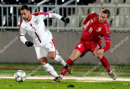 Serbia's Andrija Zivkovic (L) in action against Lithuania's Vaidas Slavickas (R) during the UEFA Nations League soccer match between Serbia and Lithuania in Belgrade, Serbia, 20 November 2018.