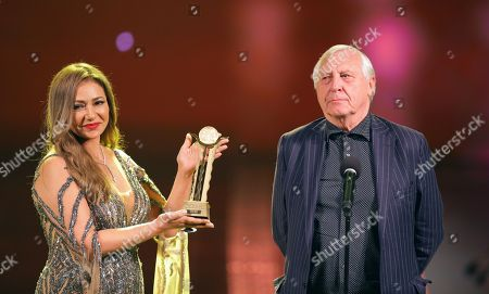 Peter Greenaway (R) receives the Faten Hamama Honorary Award from Egyptian actress Laila Elwi during the opening ceremony of the 40th Cairo International Film Festival (CIFF), in Cairo, Egypt, 20 November 2018. The CIFF runs from 20 to 29 November.