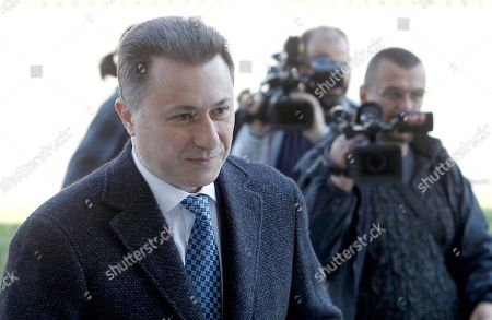 In this picture taken April 2, 2018, former Macedonian Prime Minister Nikola Gruevski, left, arrives at the criminal court in Skopje, Macedonia. Macedonia's fugitive former prime minister Gruevski said he has been granted political asylum in Hungary, a week after he fled his country to avoid serving a two-year jail sentence for a corruption conviction