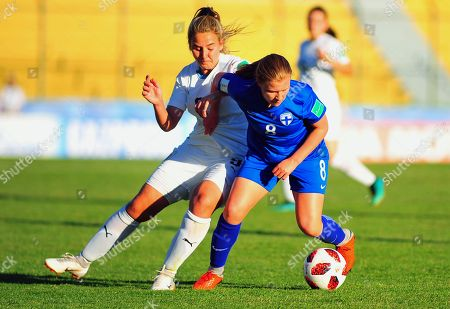 Finnish Oona Siren (R) vies for the ball with Uruguayan Cecilia Gomez (R) during the Women's Under 17 World Cup match between Uruguay and Finland, in Maldonado, Uruguay, 20 November 2018.