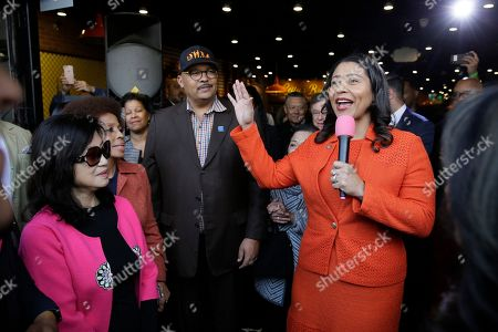 Stock Photo of San Francisco Mayor London Breed, right, speaks during the opening of Lefty O'Doul's new 20,000 square foot Baseball Ballpark Buffet & Café at Fisherman's Wharf, as Anita Lee, left, widow of former Mayor Ed Lee, listens, in San Francisco. The popular Union Square bar and restaurant Lefty O'Doul's closed in January 2017 due to a dispute between the owner and his landlord, but now the restaurant has returned on the wharf. Lefty O'Doul's was named after the well-known and respected New York Giants star outfielder. With a .398 batting average, he boasted the highest average out of any outfielder in the 20th century