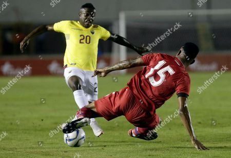 Ecuador's Jhegson Mendez, left, fights for the ball with Panama's Eric Davis during a friendly soccer match at the Rommel Fernandez stadium in Panama City