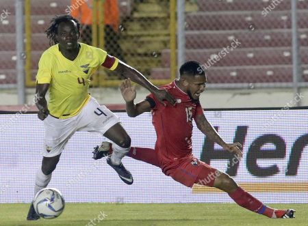 Ecuador's Juan Paredes, left, fights for the ball with Panama's Eric Davis during a friendly soccer match at the Rommel Fernandez stadium in Panama City