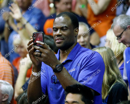 Former NBA star David Robinson takes pictures after the NCAA college basketball game between Duke and Auburn at the Maui Invitational, in Lahaina, Hawaii. Duke defeated Auburn 78-72