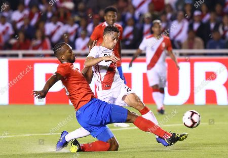 Peru's Christian Benavente (R) vies for the ball with Costa Rica's Giancarlo Gonzalez (L) during the international soccer friendly between the national soccer teams of Peru and Costa Rica at the stadium of Universidad San Agustin (UNSA) in Arequipa, Peru, 20 November 2018.