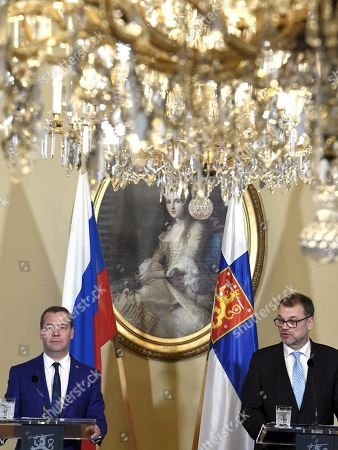 Finnish Prime Minister Juha Sipila and Russian Prime Minister Dmitry Medvedev attend a joint presser during Russian Prime Minister Dmitry Medvedev's visit