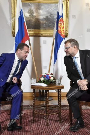 Prime Minister Juha Sipila of Finland talks with visiting Russian Prime Minister Dmitry Medvedev